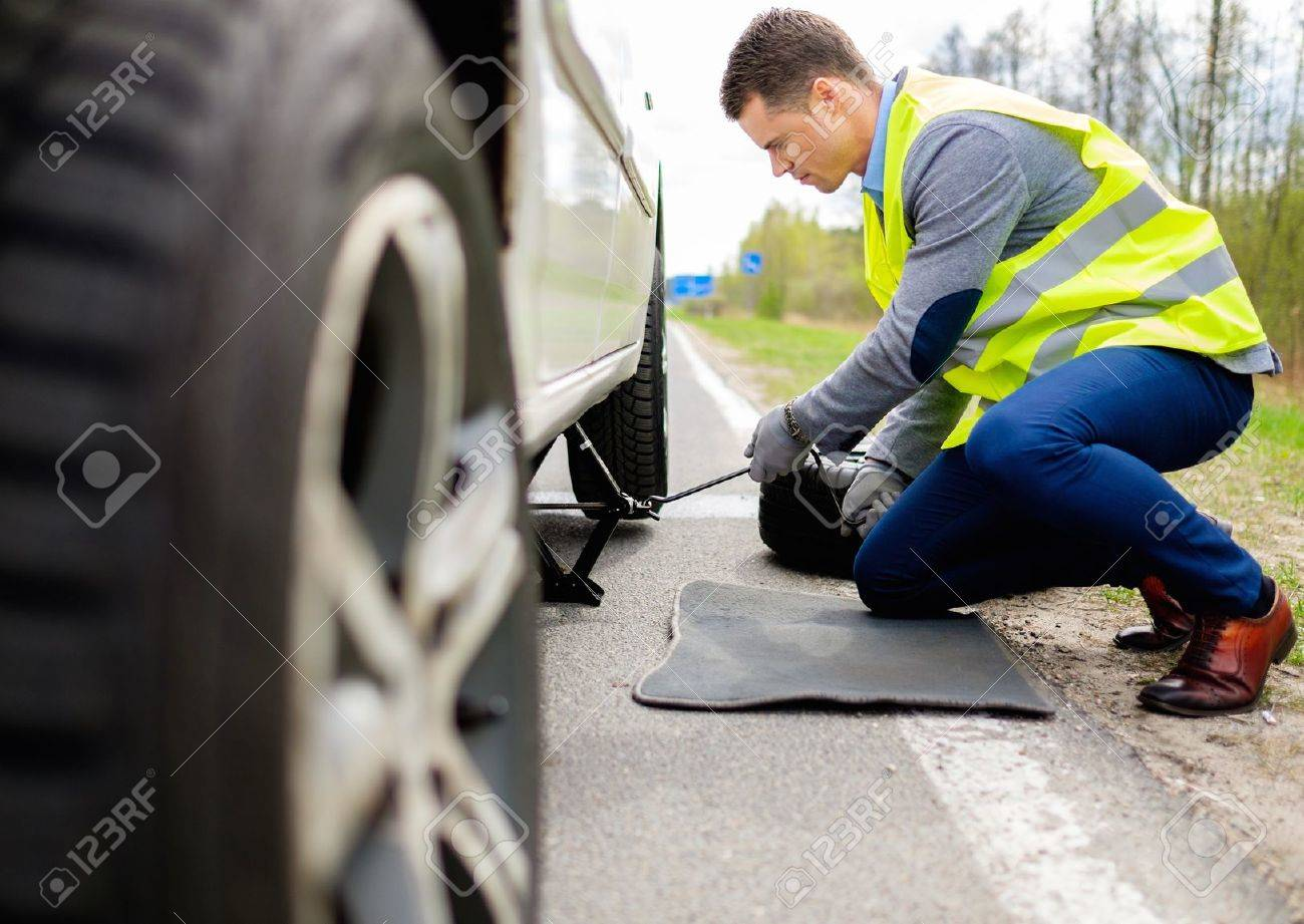 39546108 man changing wheel on a roadside Stock Photo